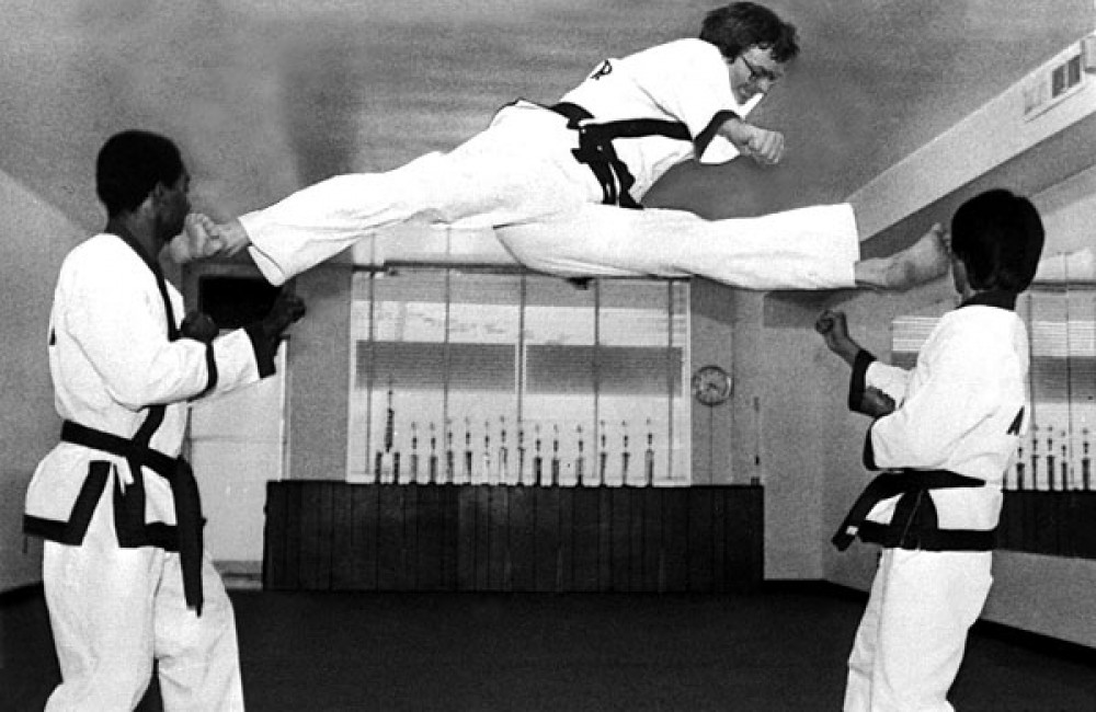 KJN Frederick Scott performing a split kick in 1979